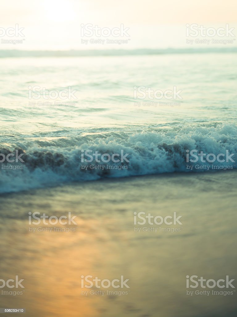 Abstract image of ocean and sand at sunset stock photo