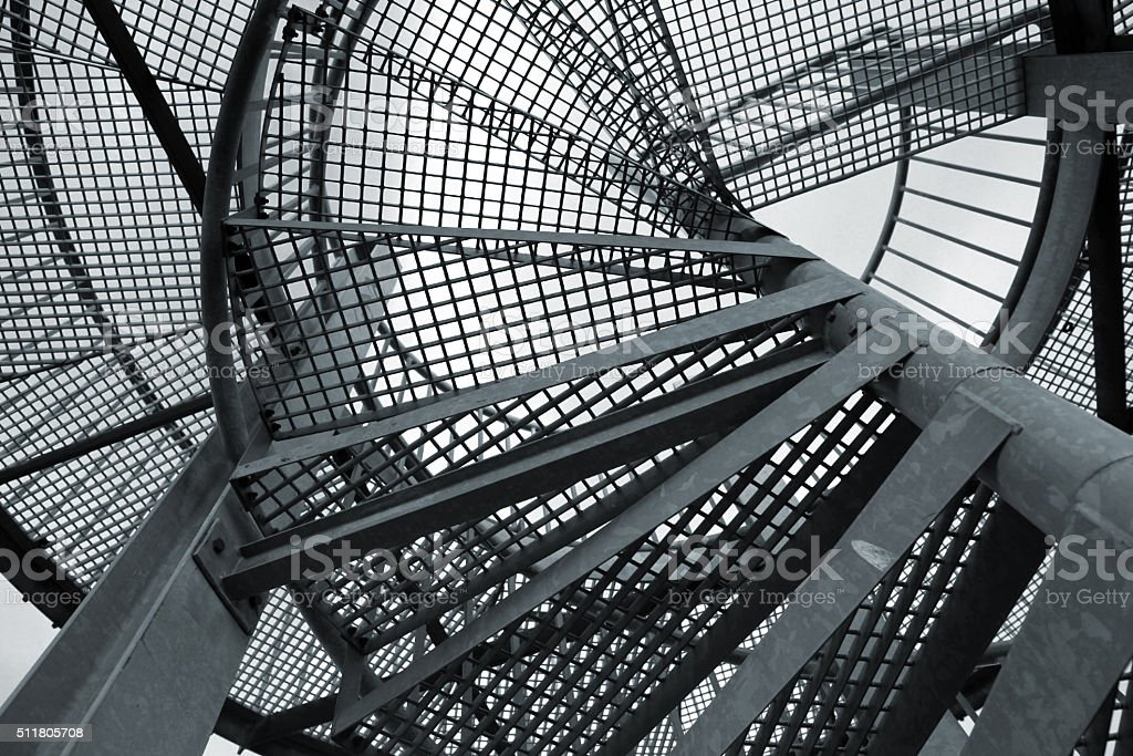Abstract industrial background with steel spiral ladder stock photo