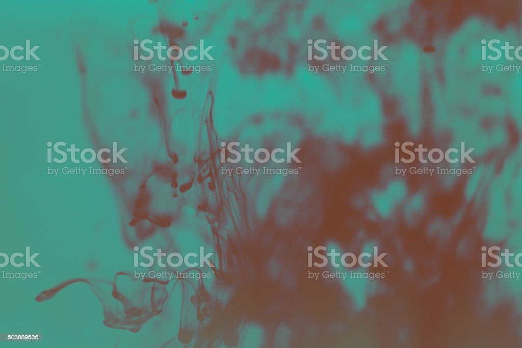 abstract ink in water purple blue stock photo