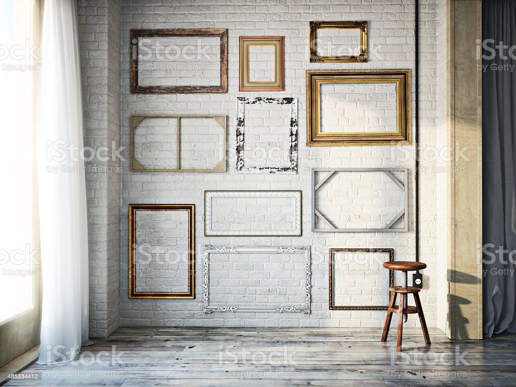 Abstract interior of assorted classic empty picture frames stock photo