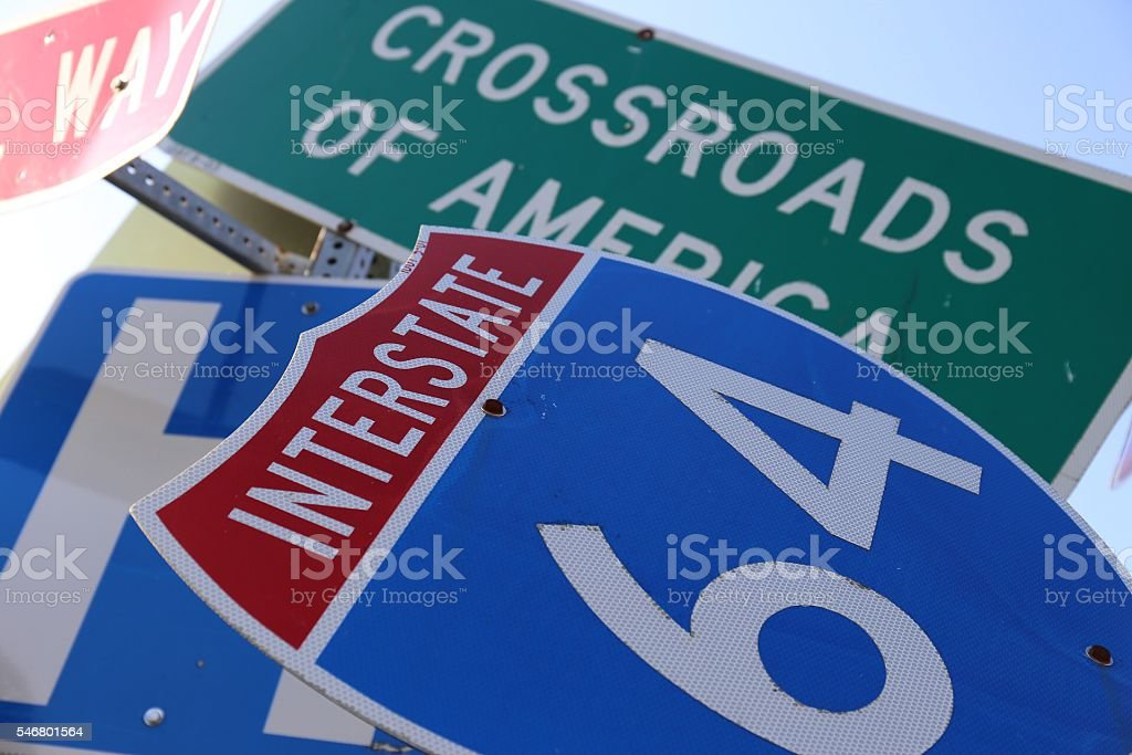 Abstract Interstate 64 and Crossroads of America signs stock photo