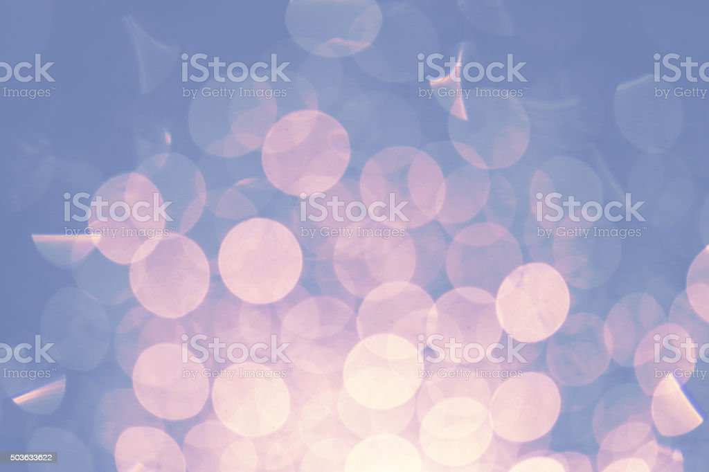 Abstract light and bokeh defocussed background in pink and blue stock photo
