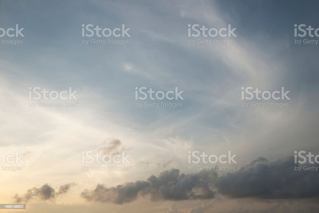 Abstract light cloud over clear yellow and blue sky stock photo