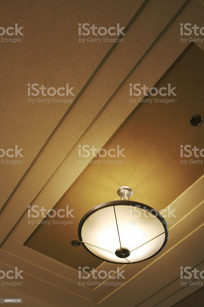 Abstract light fixture in foyer stock photo