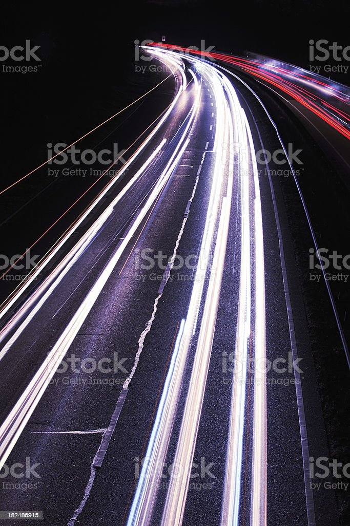 Abstract Light Trails of Cars in the Night royalty-free stock photo