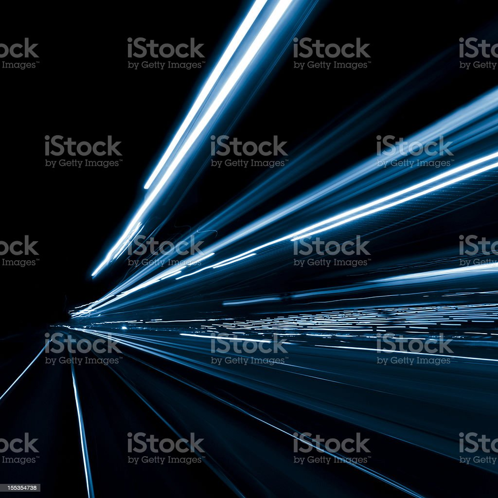 Abstract, long exposure, blue, and blurred city lights stock photo