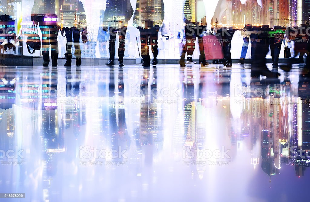 Abstract, long time exposure of pedestrians, city skyline stock photo