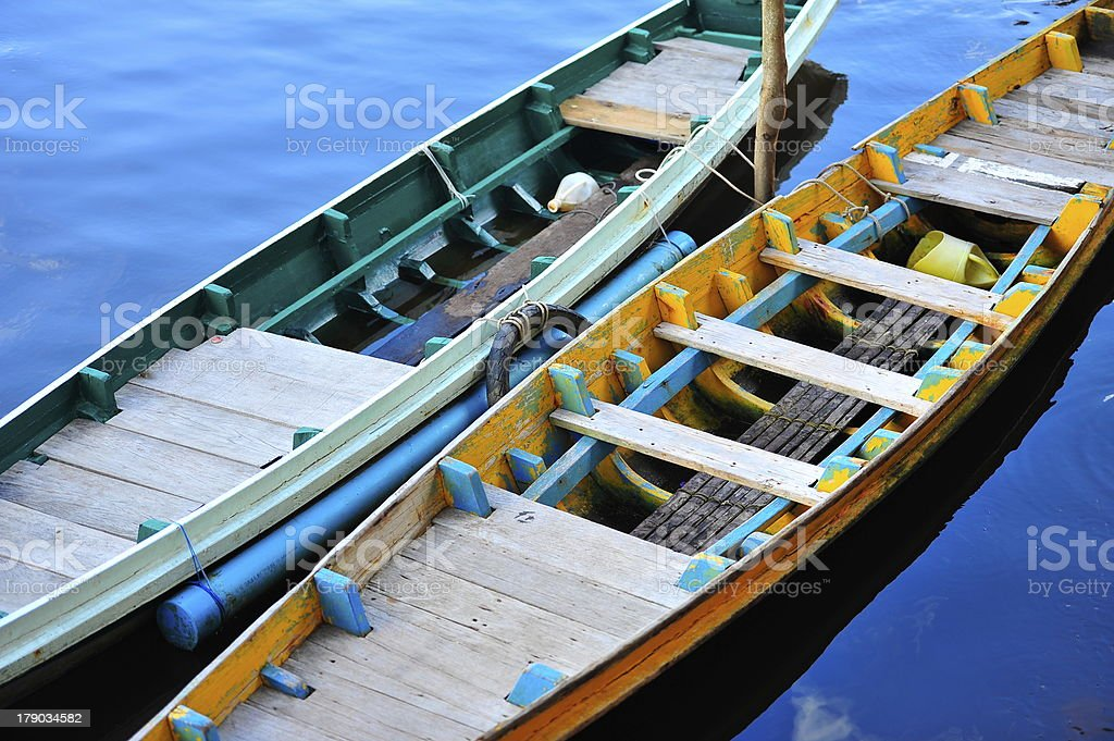 Abstract longtail boat in blue water royalty-free stock photo