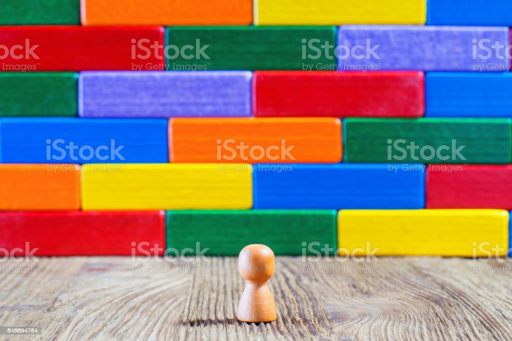 Abstract man standing in front of a wall or barrier stock photo