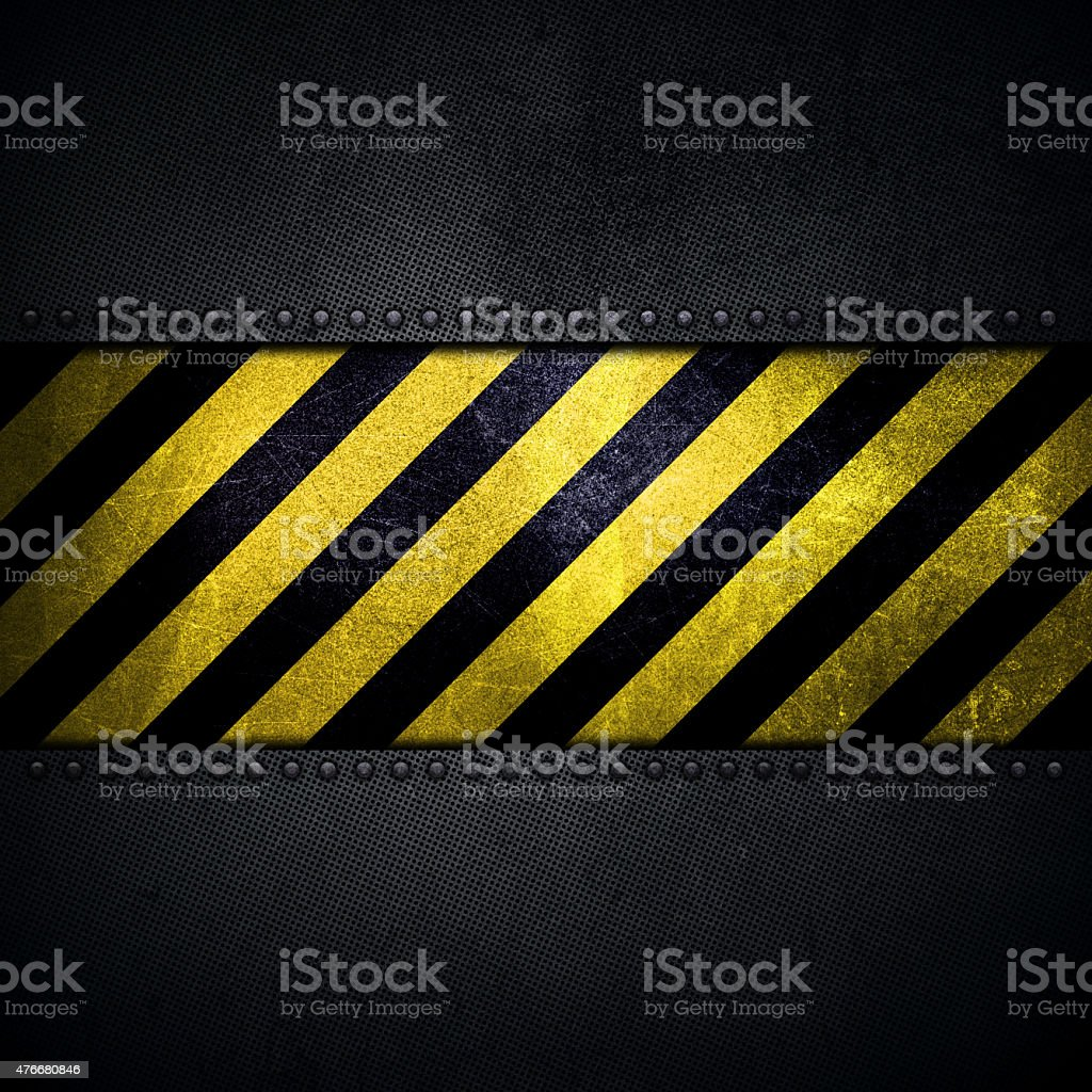 Abstract metallic background with yellow and black warning strip stock photo