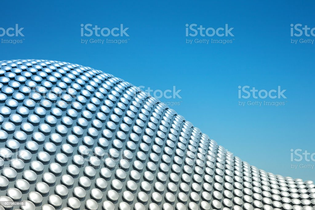 Abstract modern background, waving metal architectural pattern on blue sky stock photo