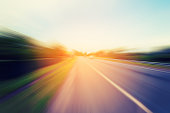 Abstract motion blur of the road with sunlight