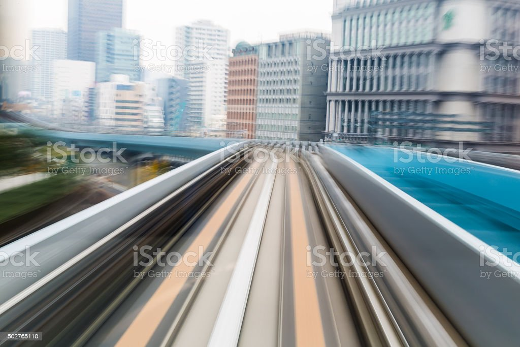 Abstract motion blurred moving train in city stock photo