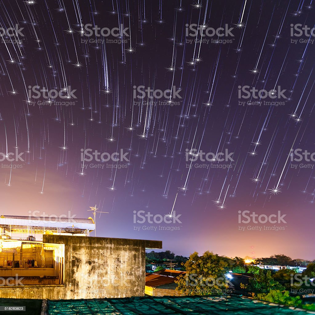abstract night sky with falling stars background stock photo