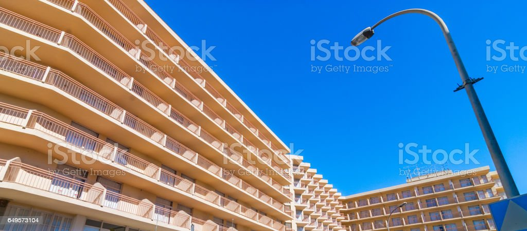 Abstract of sunlit building balcony line uniformity, street lamp in daytime. stock photo