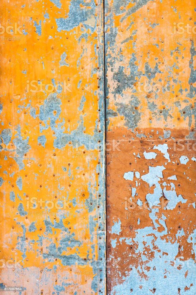 Abstract Orange and Grey Background: Weathered Peeling Metal Door stock photo