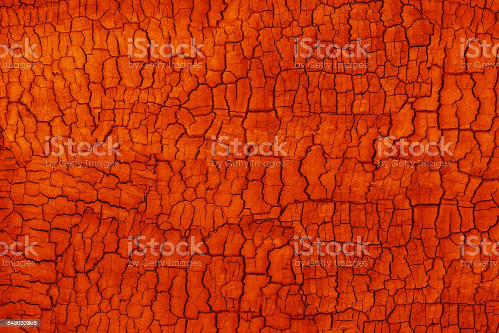 Abstract orange grunge background. Burbed wood texture with cracks stock photo