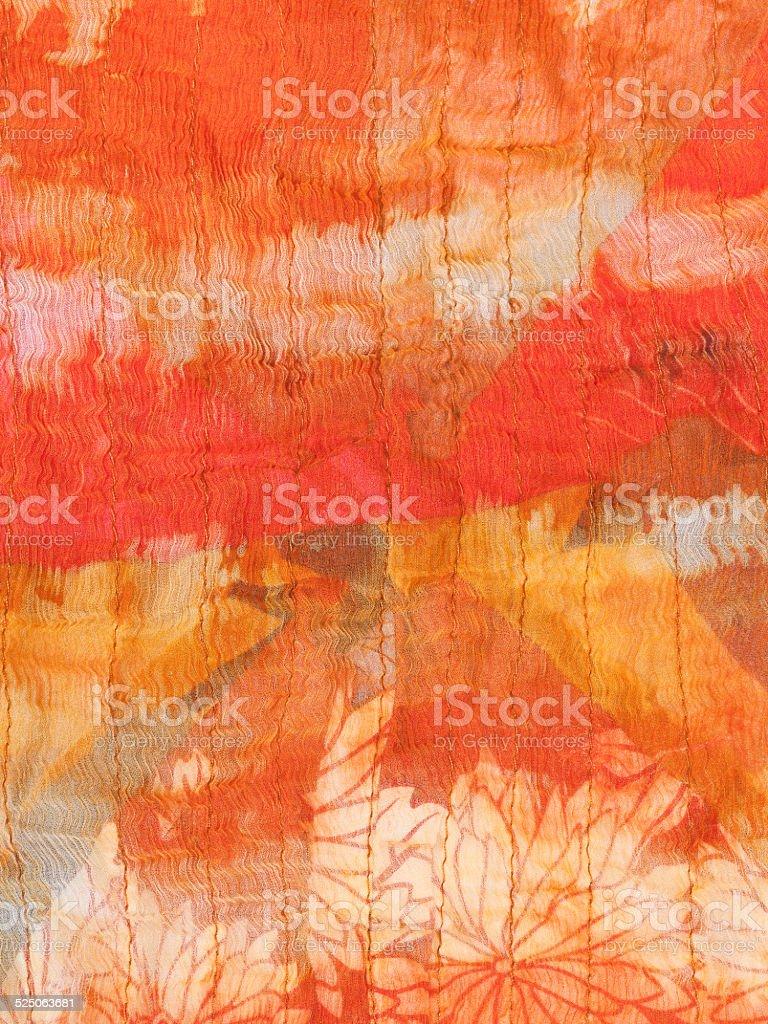 abstract ornament of painted orange silk batik stock photo