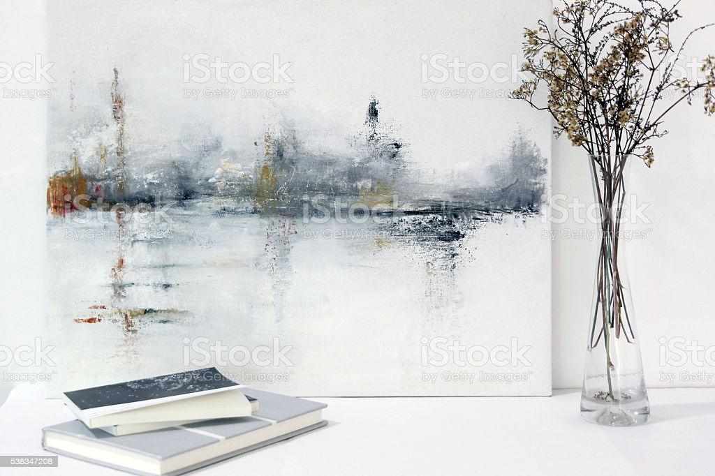 abstract painting and flowers decoration on table stock photo