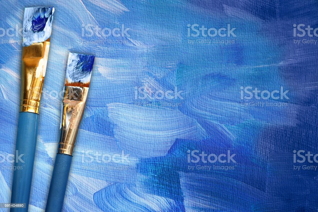 Abstract painting in blue with paint brushes stock photo