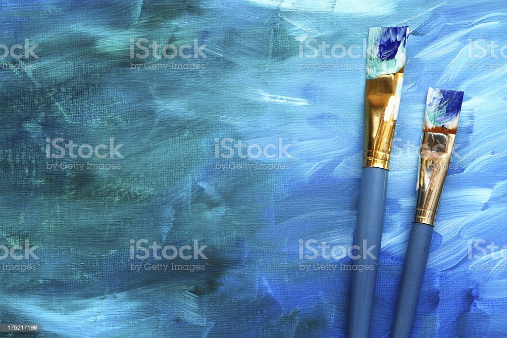 Abstract painting with paint brushes stock photo