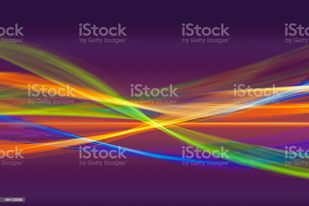 Abstract pattern of intertwined colorful light beams stock photo