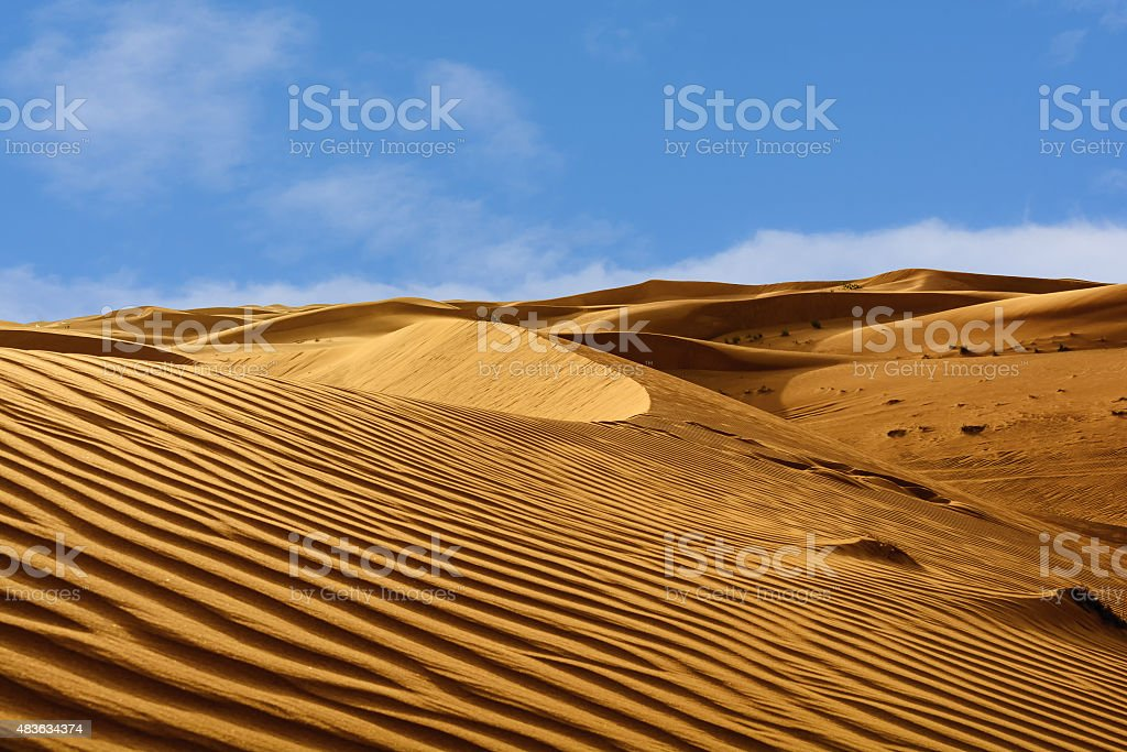 Abstract patterns in the dunes of Arabian desert stock photo