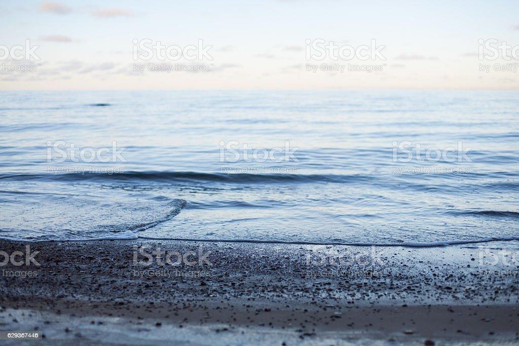 Abstract peaceful sunset at sea background stock photo