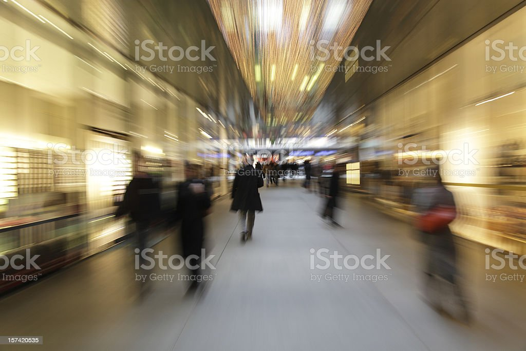 abstract people at chritmas shopping - motion blurred with zoom royalty-free stock photo
