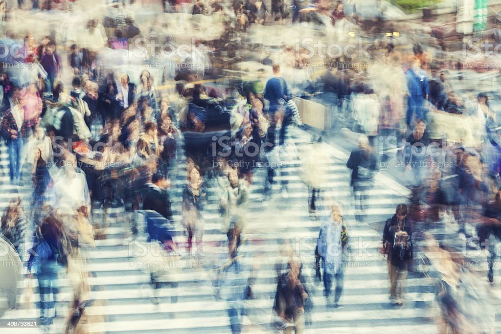 abstract people walking during rush hour stock photo
