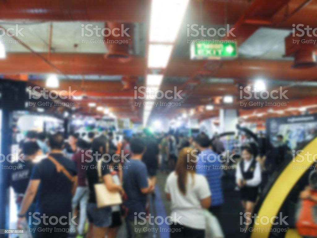 Abstract people walking in exhibition blurred background stock photo