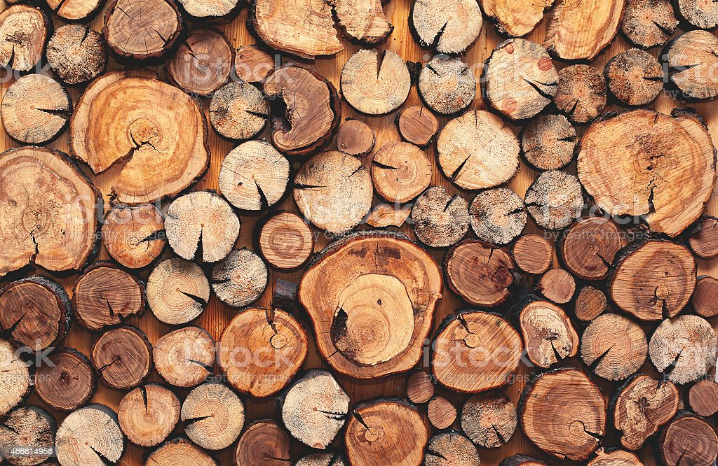 Abstract photo of a pile natural wooden logs background stock photo