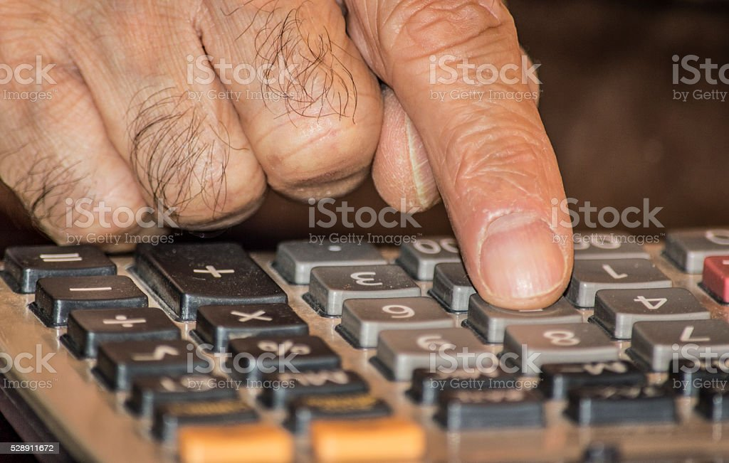 Abstract photo of doing business and calculating income tax stock photo