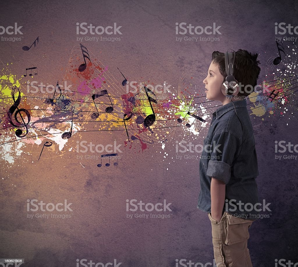 Abstract photograph of boy's reaction to music stock photo