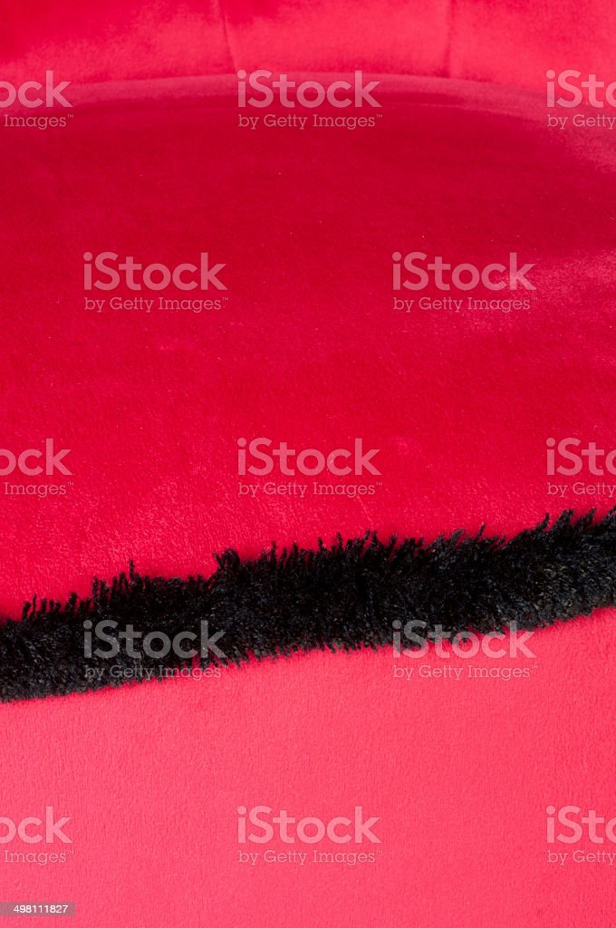 abstract pink velvet padding with black fringes stock photo
