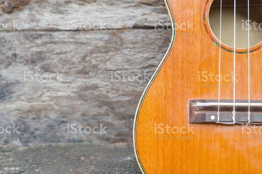 abstract portrait of a ukulele on old wood background stock photo