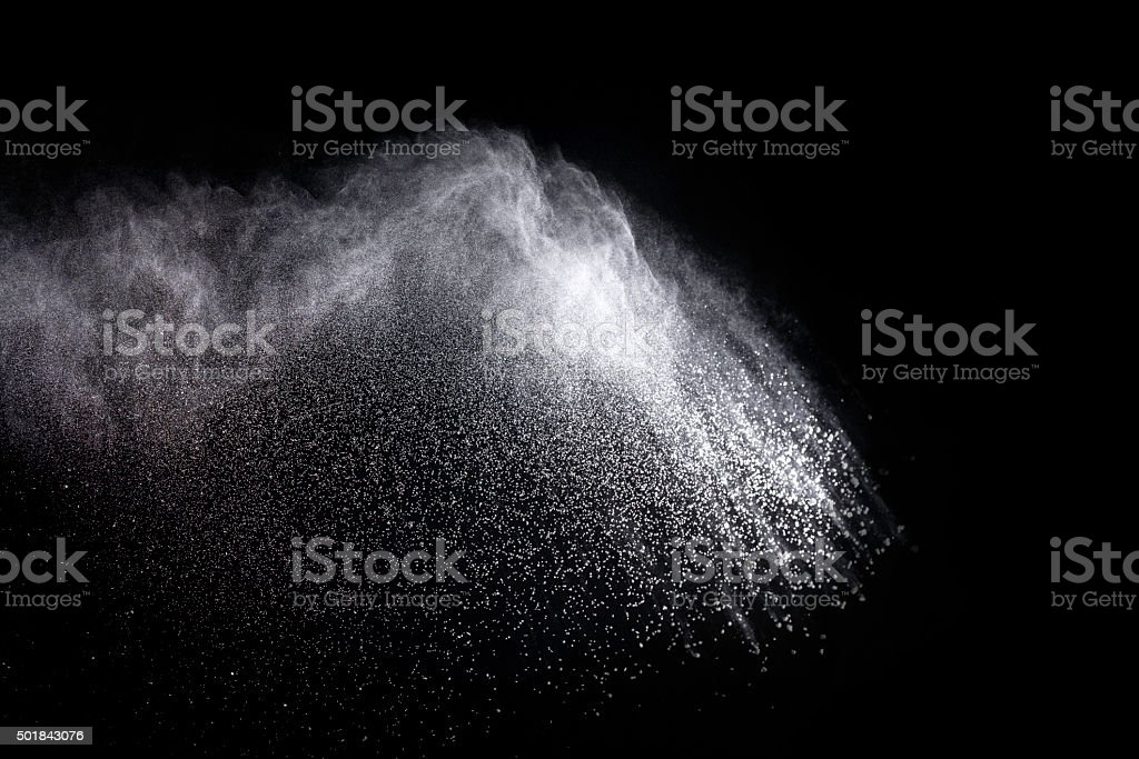 abstract powder explosion on black background stock photo