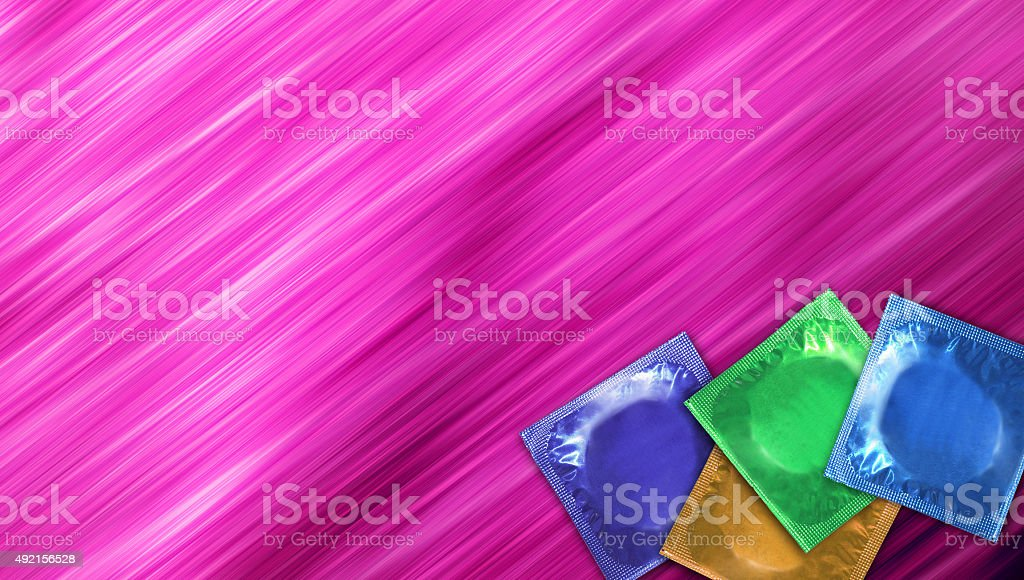 Abstract purple color background with color condoms stock photo