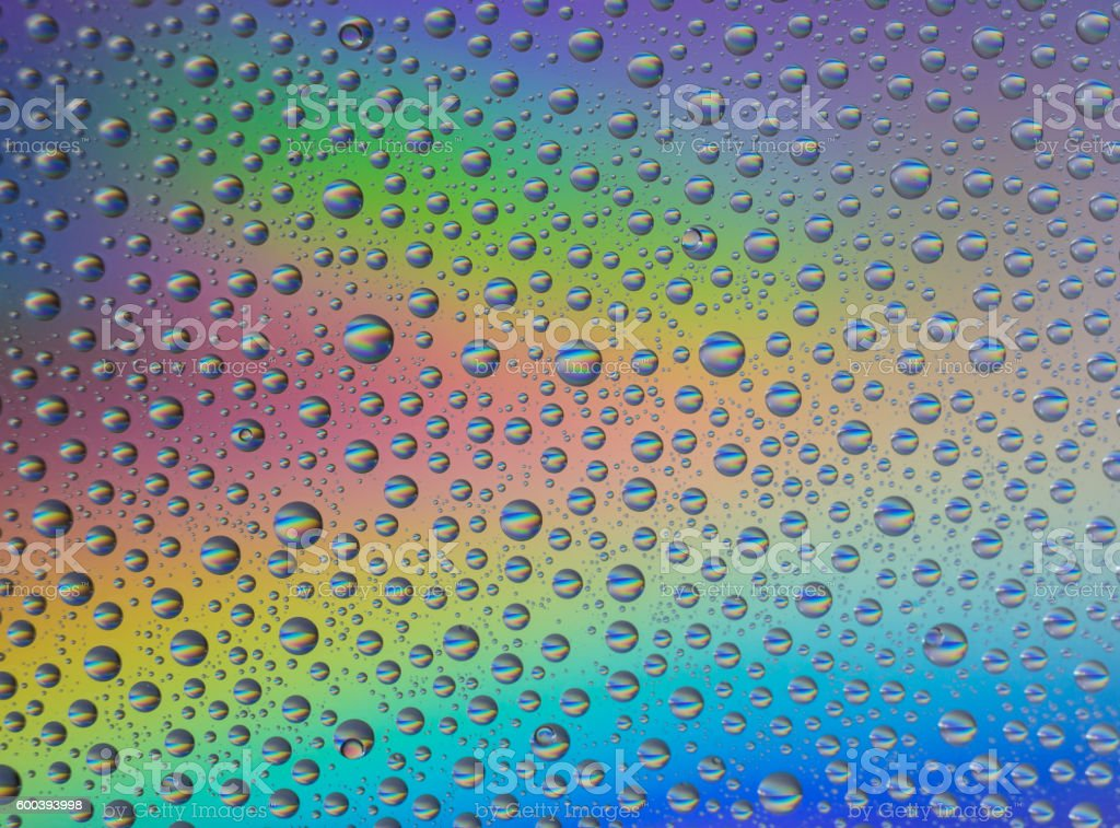 Abstract rainbow drops background stock photo