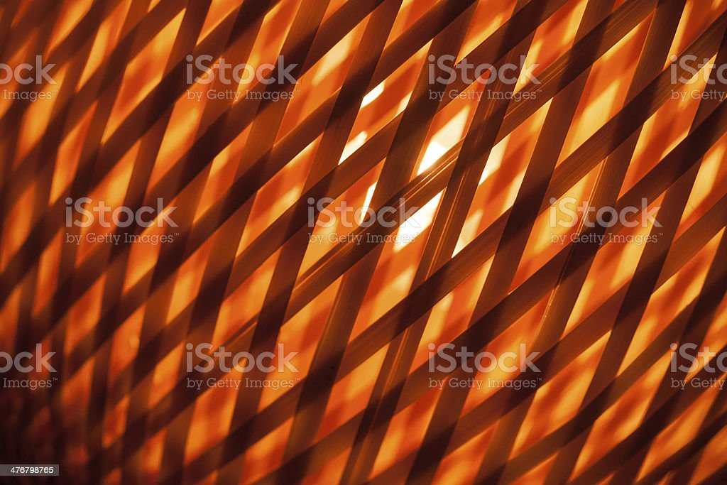 Abstract red background with macro of wicker lampshade stock photo