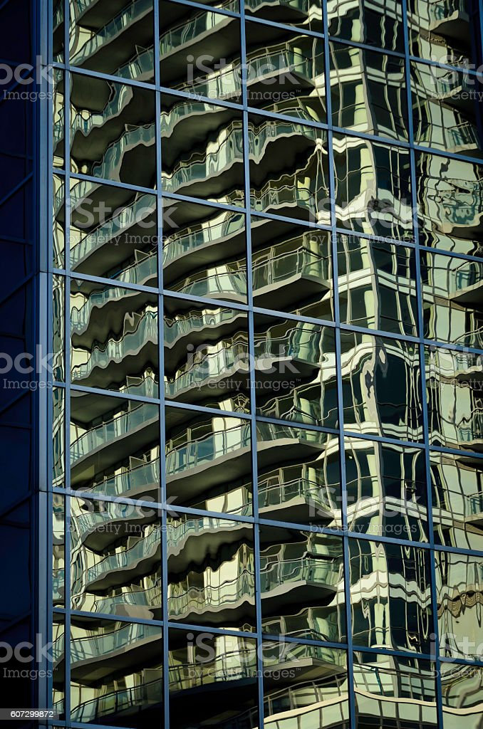 Abstract reflections of afternoon light reflected on an office building royalty-free stock photo