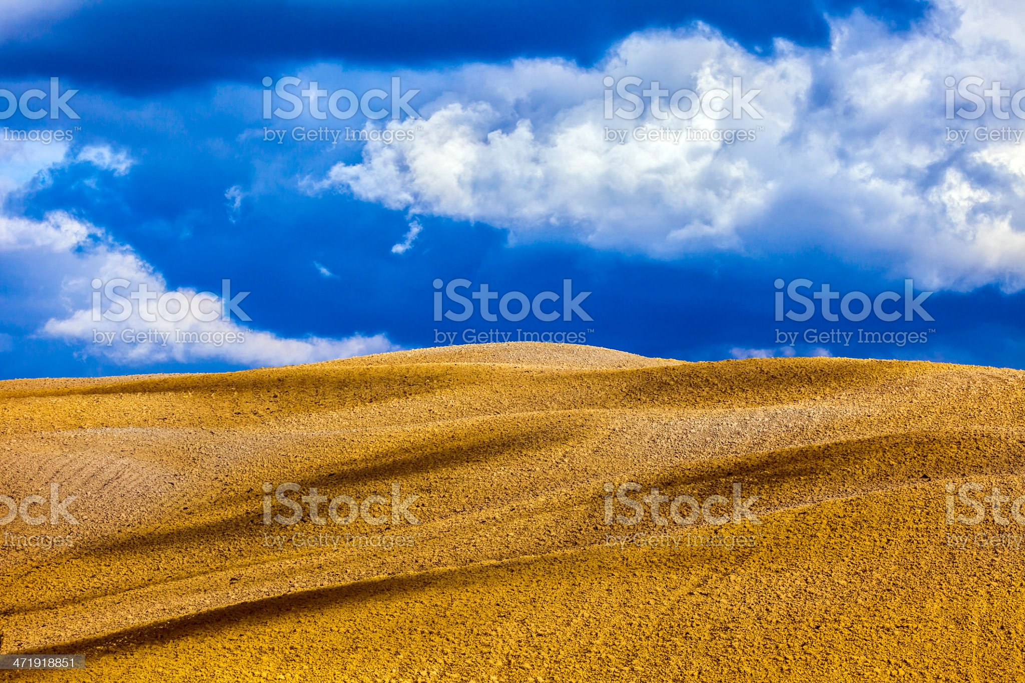 Abstract Rolling Hills Under Dramatic Sky, Tuscany, Italy royalty-free stock photo