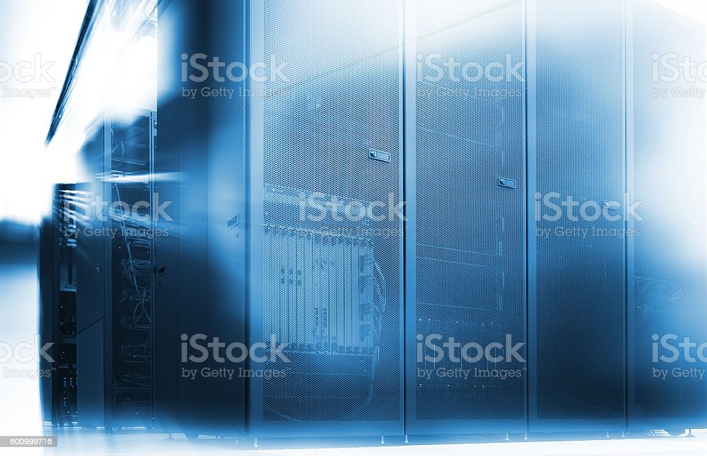 abstract room with rows of server hardware in data center stock photo
