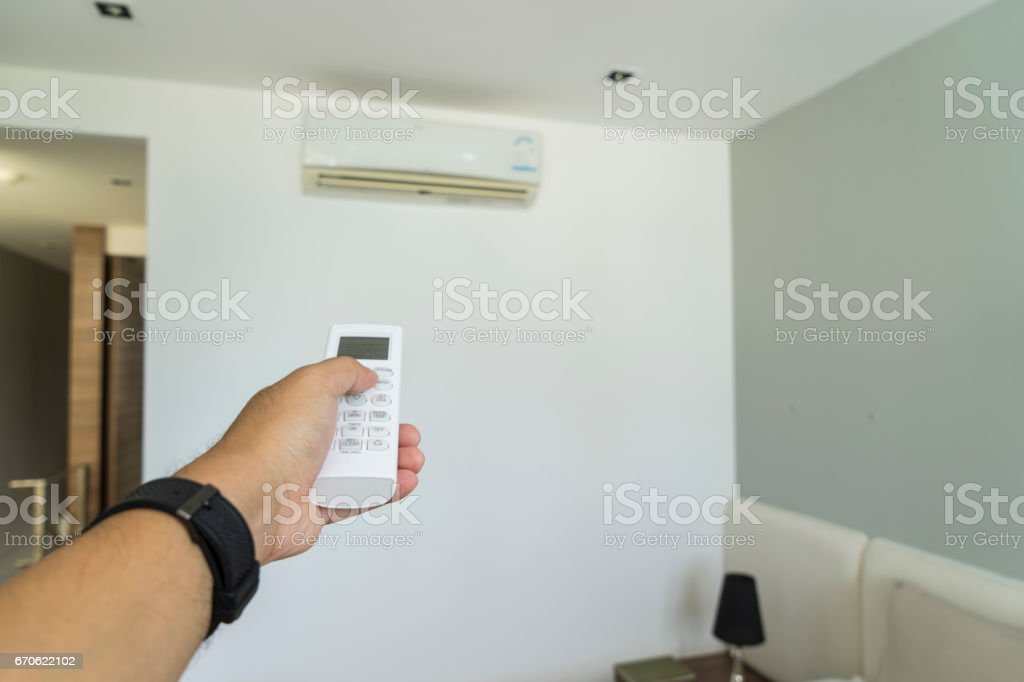 abstract scene of push remote air controls in the room stock photo