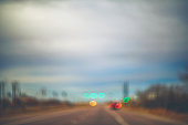 Abstract scenic background with road, car lights and traffic lights