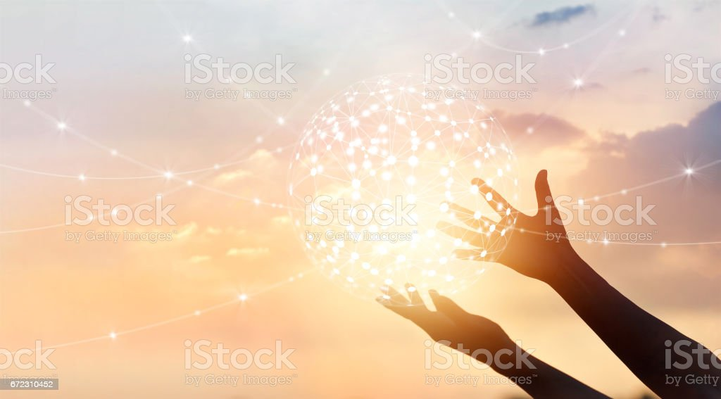 Abstract science, circle global network connection in hands on sunset background stock photo