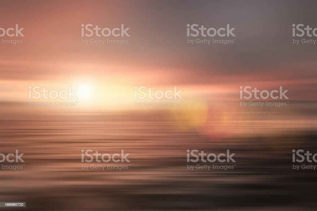 Abstract seascape with moody sky and dreamlike sunrise stock photo