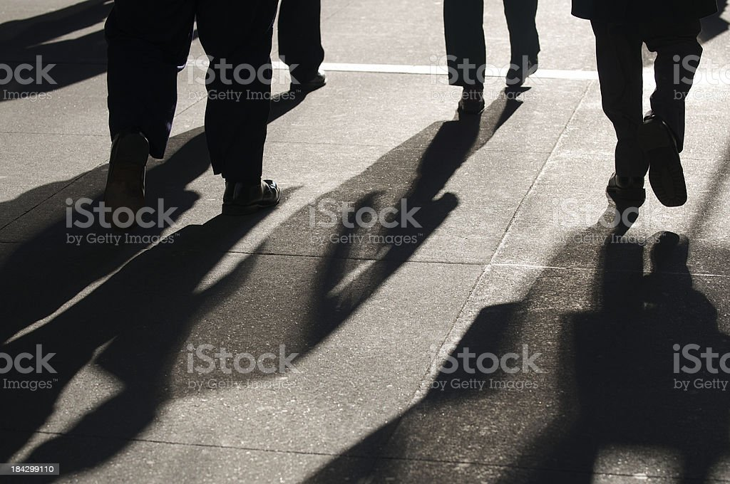 Abstract Shadows of Businessmen Walking stock photo