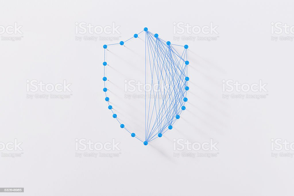 Abstract shield made by strings and pins,network safety concept stock photo