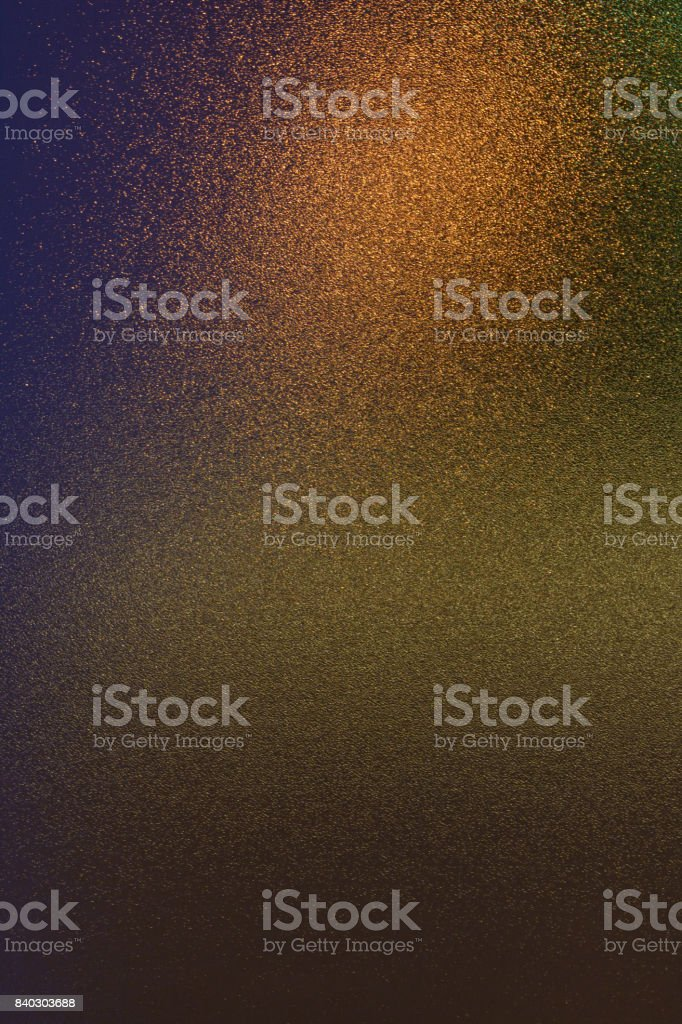 Abstract shiny reflections of colorful lights on a grainy glass surface stock photo
